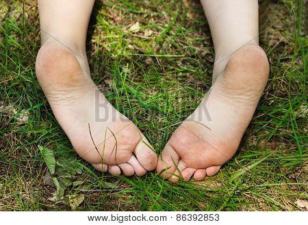 Feet Of Little Girl Outdoors