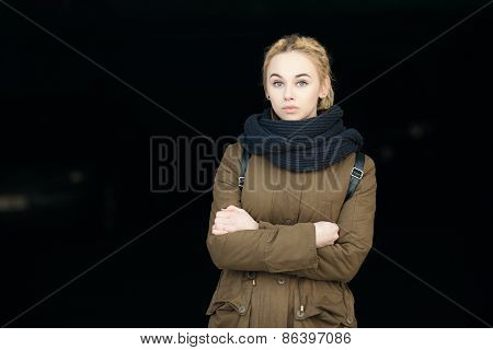 Outdoors portrait of young beautiful blonde hipster woman in olive parka with a dreadlocks bun hairs