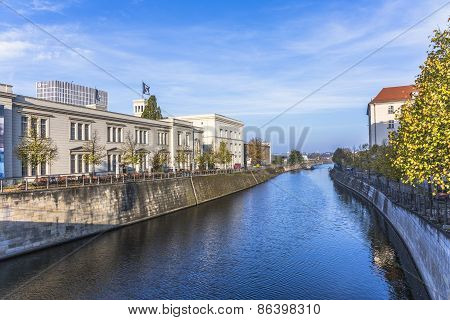 Berlins Buildings And A Boat Shipping At The River Spree