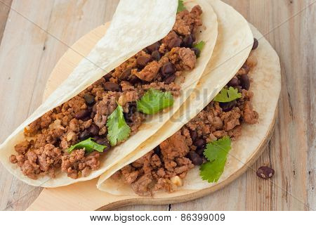 Two Meat Tacos With Black Beans Garnished With Cilantro