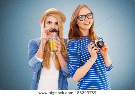 Two hipster girls isolated on white background.