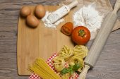 pic of pasta  - Still life with raw homemade pasta and ingredients for pasta - JPG