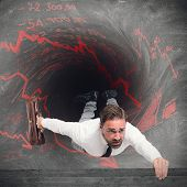 picture of swallow  - Businessman swallowed by the tunnel of debts - JPG