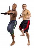 stock photo of filipino  - Martial Arts instructor teaching a student the Filipino Martial Art Kali Escrima or Arnis with fighting sticks - JPG