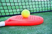 stock photo of paddling  - Paddle tennis racket and ball in paddle tennis field - JPG