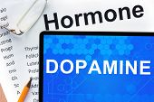 image of hormones  - Papers with hormones list and tablet  with word dopamine - JPG