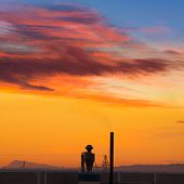 picture of valencia-orange  - Industrial chimney at sunrise in Paterna Valencia at Spain - JPG