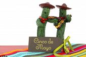 foto of mexican fiesta  - Happy Cinco de Mayo concept with fun Mariachi Band Cactus players and greeting card on red wood table - JPG