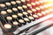 image of typewriter  - Old vintage typewriter keys in this retro creative writing and relaxation themed desk top - JPG