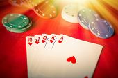 image of poker hand  - Heavenly light illuminates a winning hand in this poker background photo - JPG