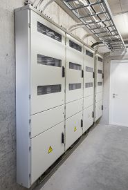 stock photo of electricity meter  - Electricity boxes and meters in apartment building - JPG