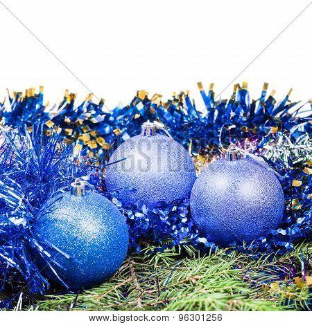 Blue Christmas Balls On Green Fir Tree Branch