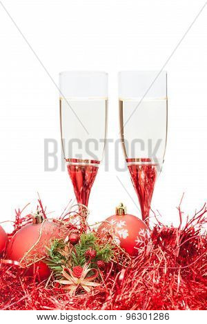 Two Glasses Of Champagne And Angel Figure At Red