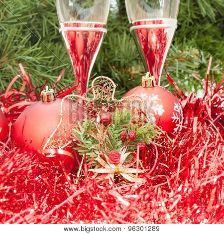 Two Glasses With Red Xmas Decorations And Tree 1