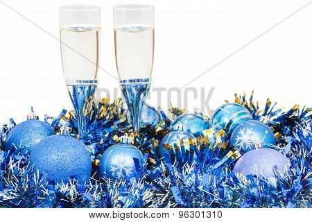 Glasses Of Champagne At Blue Christmas Decorations