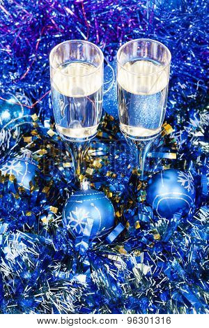 Above View Glasses In Blue Xmas Balls And Tinsel