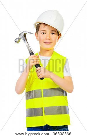 A boy in a costume of a builder posing with a hammer. Isolated over white.