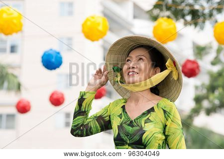 Woman In A Wide-brimmed Bamboo Hat