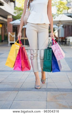 Woman walking with shopping bags at the shoppingmall