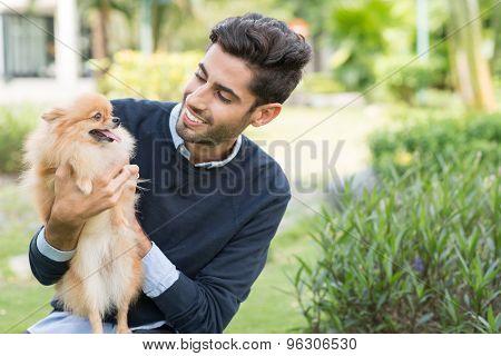 Man With Pomeranian Spitz