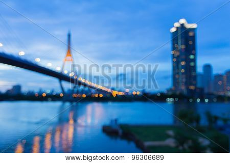 Abstract blur bokeh background, Suspension Bridge with water reflection