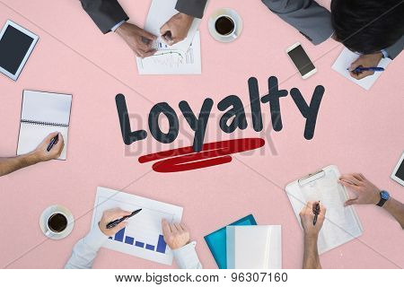 The word loyalty against business meeting
