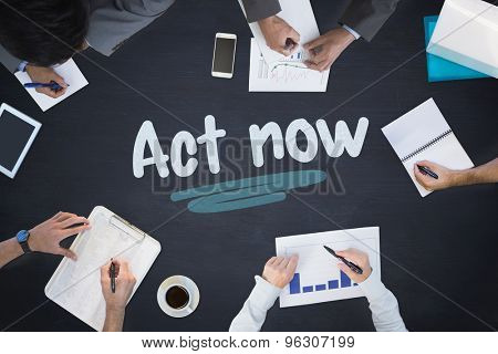 The word act now and business meeting against blackboard