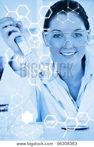 Science graphic against portrait of a redhead scientist preparing