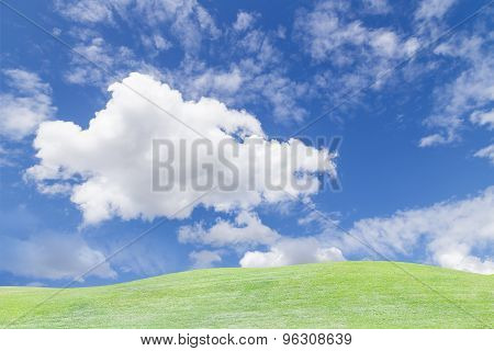 Sky And Cloud Over Green Grass Hill