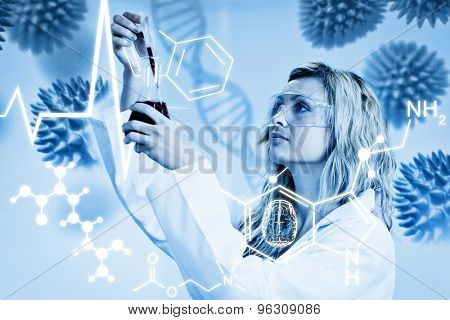 Science graphic against woman looking at beaker of red liquid