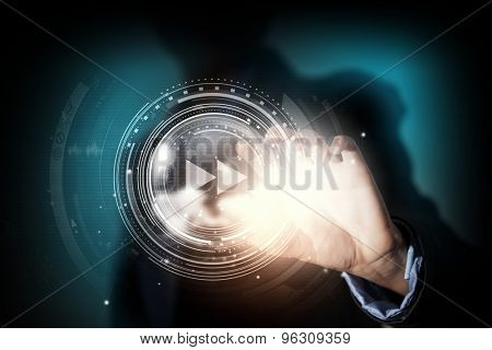 Close up of businesswoman pressing media play icon