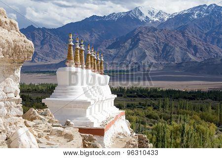 Buddhist Chortens (stupa) And Himalayas Mountains In The Background Near Shey Palace In Ladakh, Indi