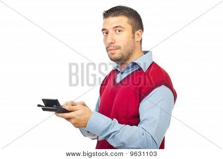 Corporate Man Using Calculator