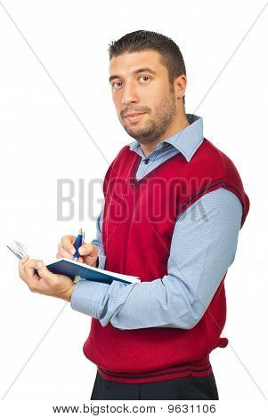 Executive Man Holding Agenda And Pencil