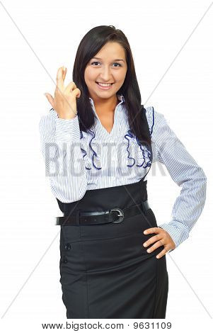 Young Executive Woman Holding Fingers Crossed