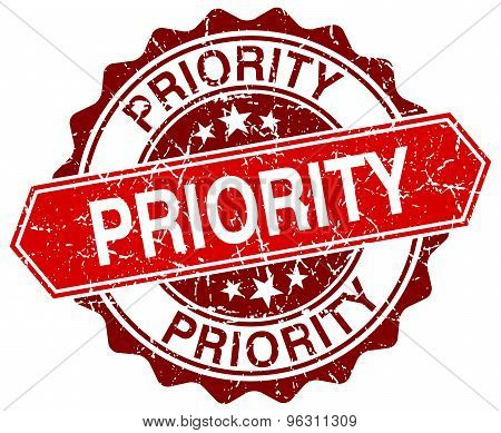 Priority Red Round Grunge Stamp On White