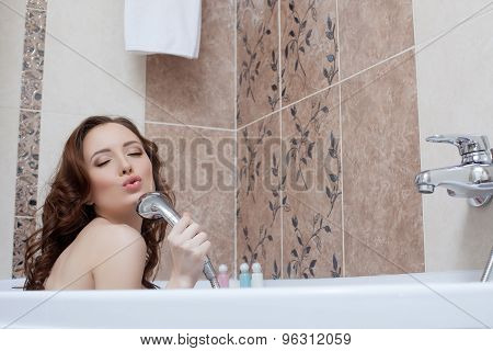 Woman fooling around while singing in bathroom