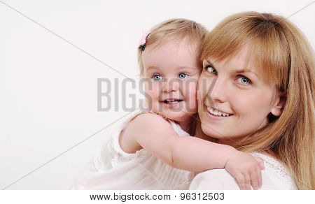 Mother And Her Cute Little Baby Girl Having Fun At Home