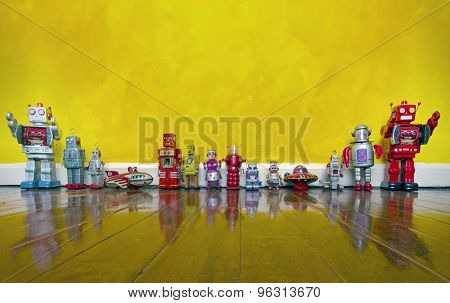 old tin toys on a wooden floor