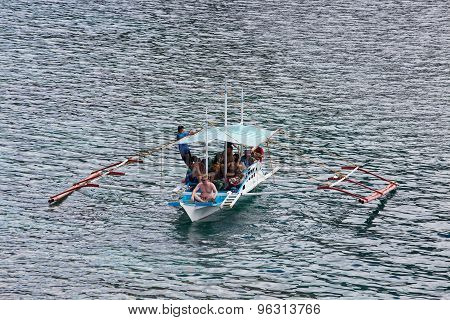 Boat With Tourists To Travel Between The Islands. El Nido, Philippines