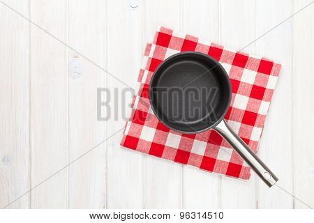 Kitchen utensil over white wooden table background. View from above with copy space