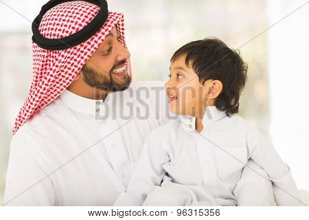 playful middle eastern father and son