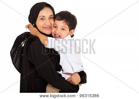 cute little muslim boy hugging his mother