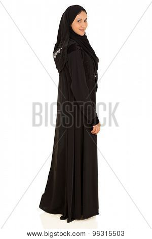 pretty young muslim woman looking back isolated on white