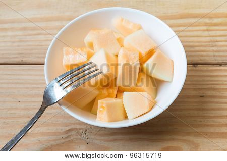 Cantaloupe In White Dish With Fork 2