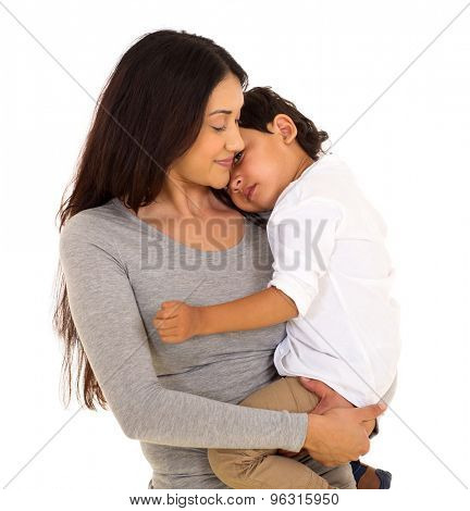 beautiful indian woman carrying her little boy isolated on white background