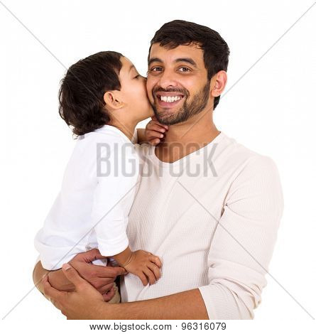 indian boy kissing his dad isolated on white background