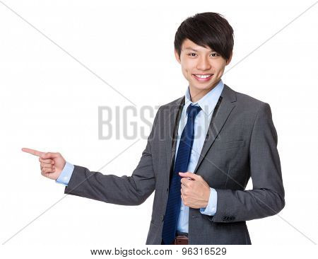 Asian businessman with finger point aside