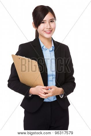 Asian young businesswoman hold with clipboard