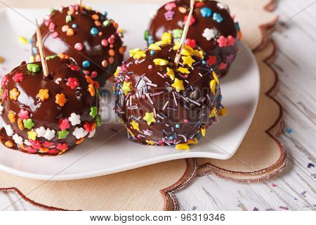 Fresh Apples In Chocolate With Candy Sprinkles On A Plate. Horizontal